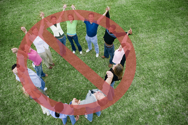 self-organization group holding hands in a circle